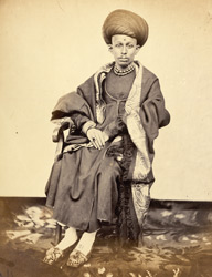 Full-length seated portrait of a Shawak Bania, Bombay.